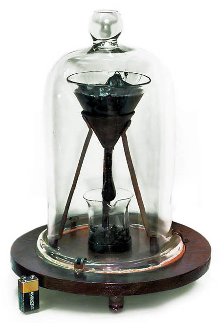 University of Queensland Pitch Drop Experiment (battery for size comparison)